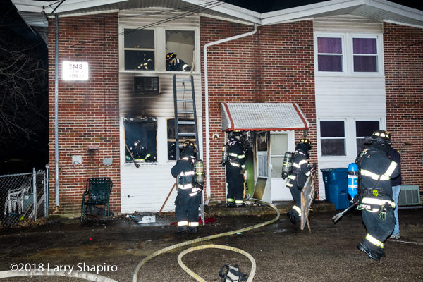 firefighters after battling an apartment fire