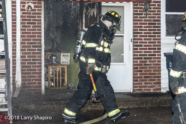 firefighter in PPE after battling a fire