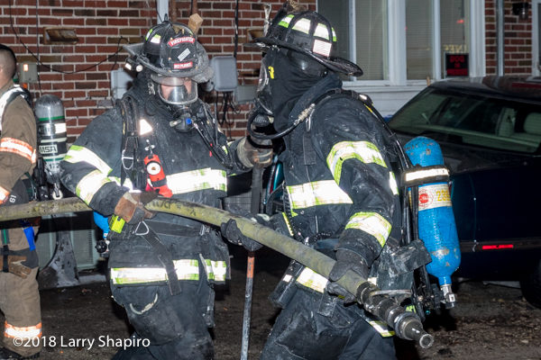 firefighters in PPE after battling a fire