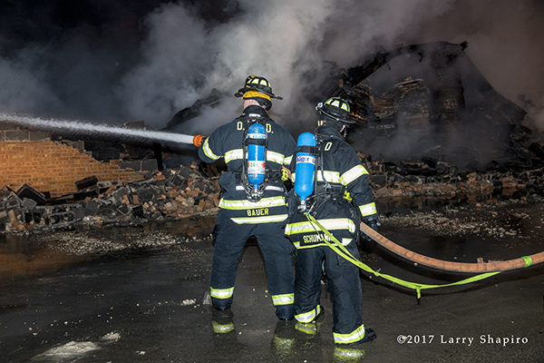 Des Plaines Firefighters with Draeger SCBA fighting a fire
