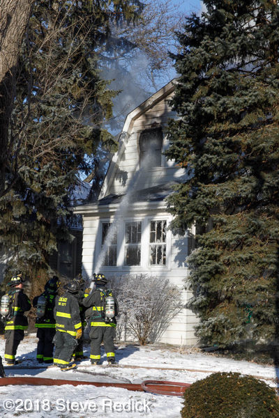firefighters battle Chicago house fire