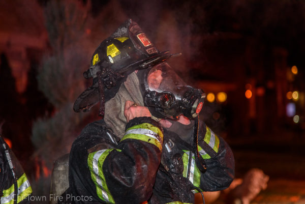 Firefighter with PPE and ice after a fire