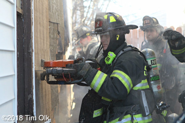 firefighter uses a saw