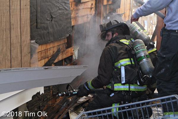 firefighter overhauls after a fire