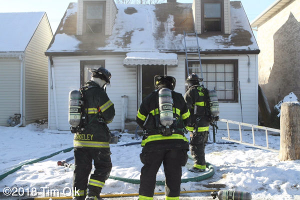 firefighters at winter house fire