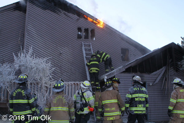 firefighters overhaul house after a fire