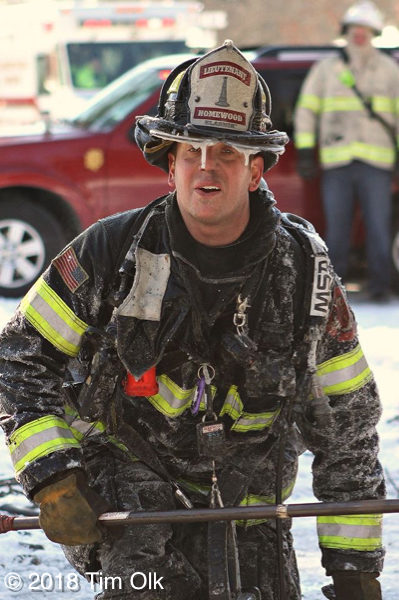 firefighter covered with ice