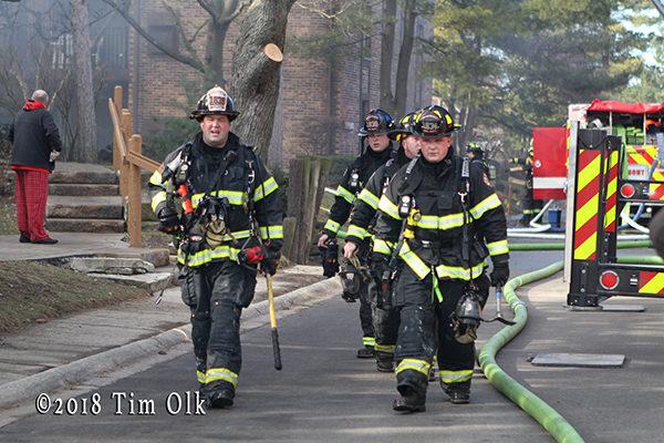 firefighters approaching fire scene