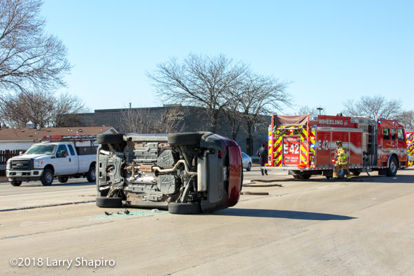 rollover crash scene with fire engine