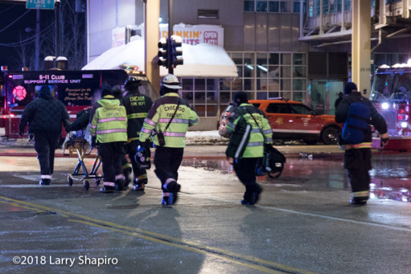 Chicago FD paramedics remove an injured person