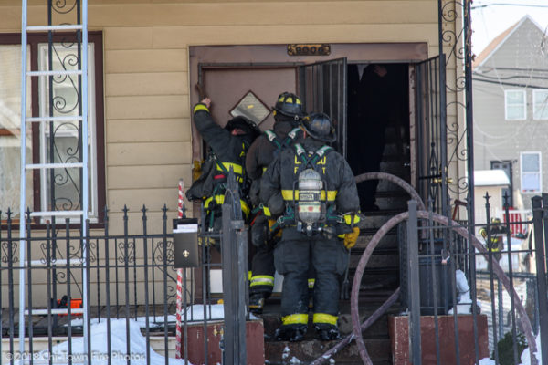 Firefighters with PPE at house fire