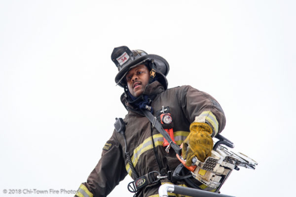 African American Firefighter with saw and PPE