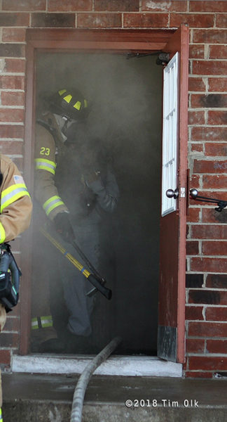 Firefighter at doorway