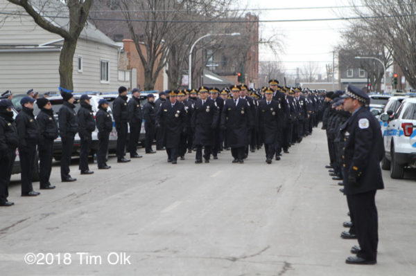 Chicago police officers march in funeral procession