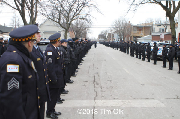 Chicago police officers line street of funeral procession