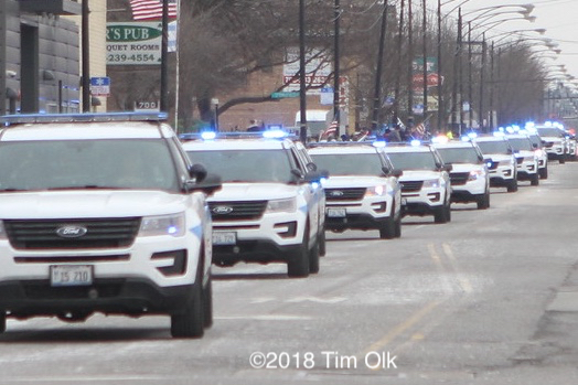 Chicago police cars in funeral procession