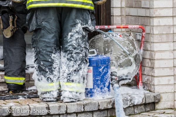 Firefighters use foam to fight basement fire