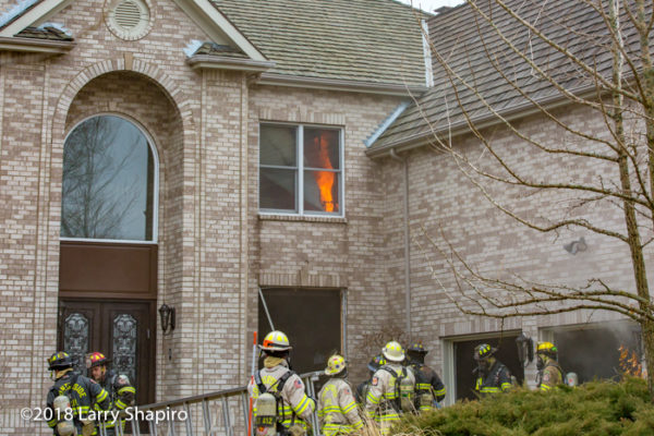 house fire with flames on the second floor