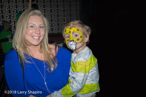 mom holding boy with Lion King fan paint