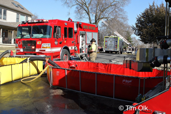 portable water tank on the ground with fire trucks