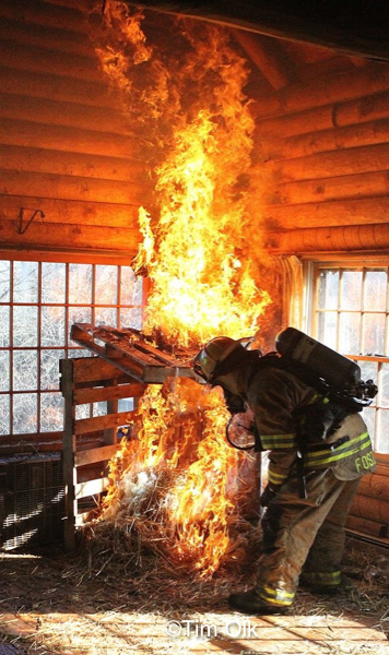 Firefighter lights stay and pallets on fire for training