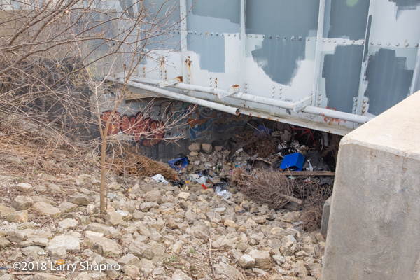 rail bridge underpass with debris