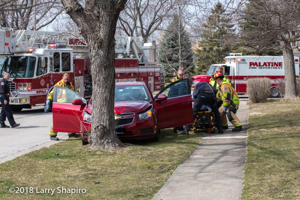 Firefighters remove patient from crash to gurney