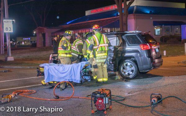 Firefighter/paramedics remove victim after car crash