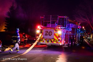 Deerfield-Bannockburn FPD Truck 20 leads out a supply line