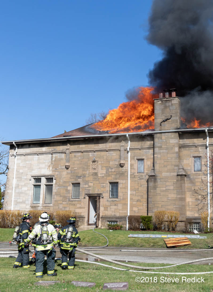 Firefighters battle roof fire
