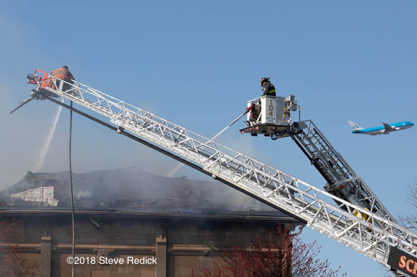elevated master streams work at a fire