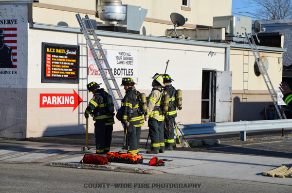 Firefighters on scene with ladder