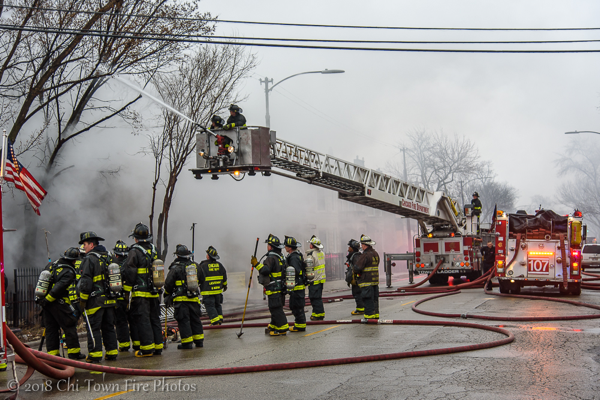 Chicago Firefighters and fire trucks at work