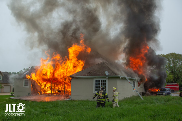 flames engulf suburban home