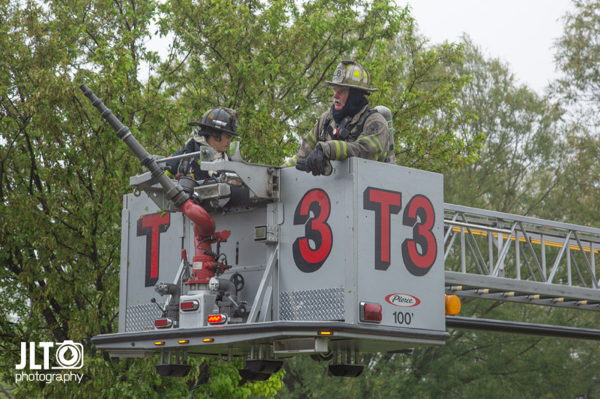 Firefighters in tower ladder bucket