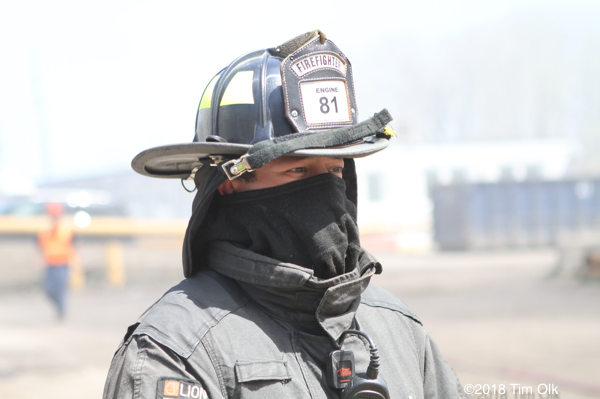 Firefighter using Nomex hood to block smoke