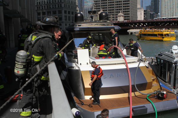 Firefighters extinguish an engine fire on a boat