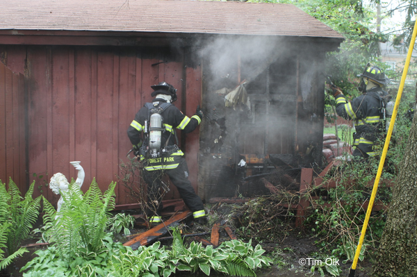 Firefighters fight garage fire