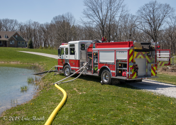 Lowell FD engine drafting from a pond