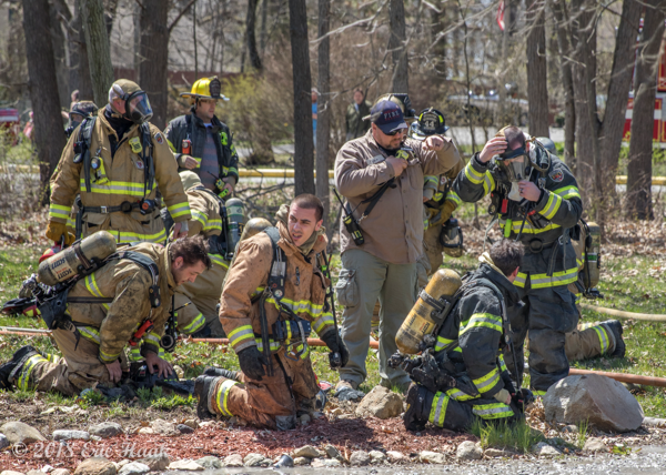 Firefighters rest after battling fire