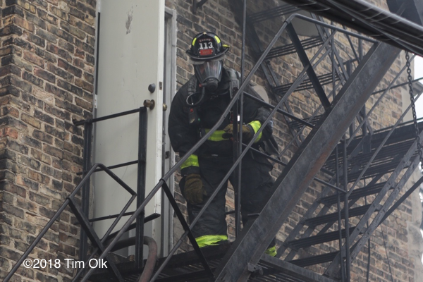 Firefighter on a  fire escape