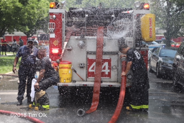 Firefighter cools down on a hot day