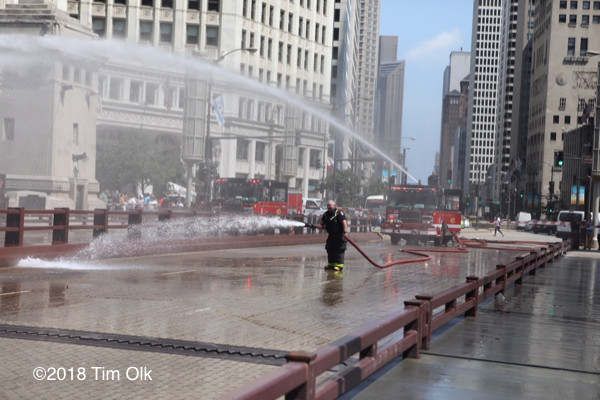 Chicago Firefighters cool bridge on hot day