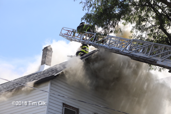 heavy smoke vents from attic of house