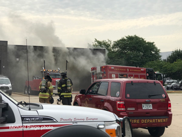 Firefighters at the scene of a trash compactor fire