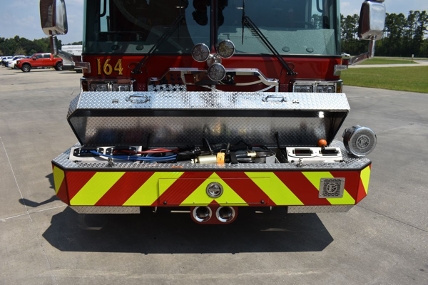hydraulic extrication tools in front bumper of fire truck