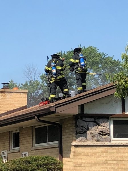 Des Plaines firefighters at a fire scene