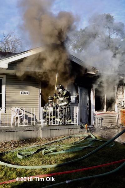 Firefighters battle a house fire