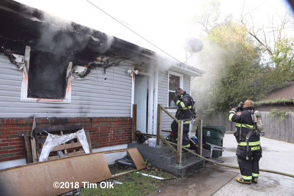 Firefighters battle a house fire