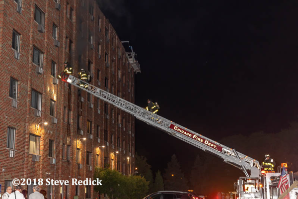 Chicago Firefighters work off aerial ladder